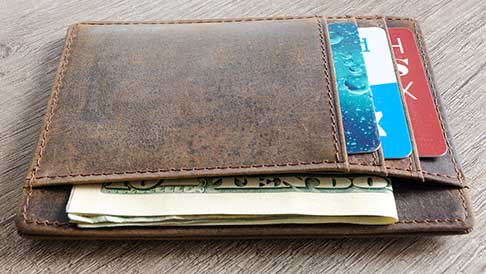 Brown leather wallet with cards and money